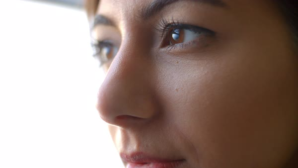 Extreme close-up of a young woman's face blinking and smiling Royalty-free stock video