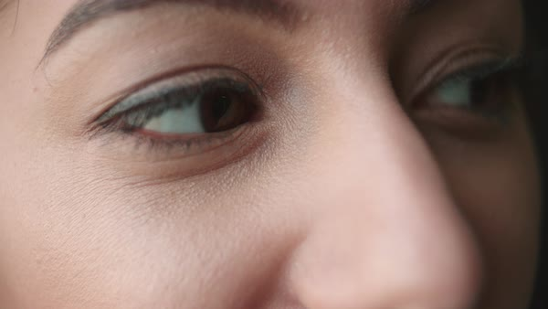 Detail of woman's eyes looking around and blinking Royalty-free stock video