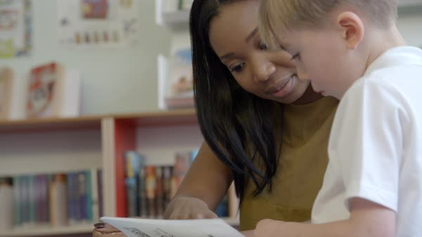 Teacher And Pupils Reading In Library Royalty-free stock video