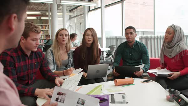 Group Of Students In Library Collaborating On Project Royalty-free stock video