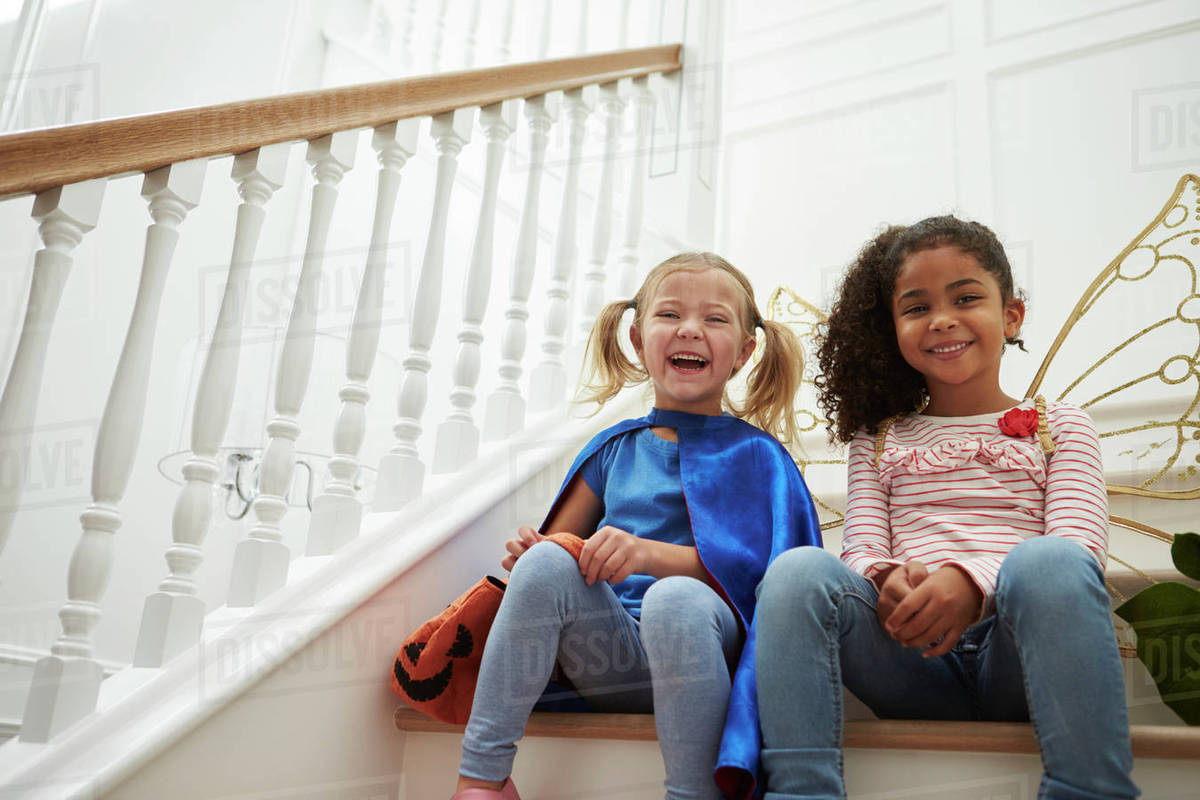 Two Girls Playing Dressing Up Games Sitting On Stairs Royalty-free stock photo