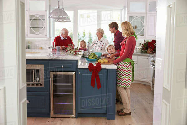 Family with grandparents preparing Christmas meal in kitchen Royalty-free stock photo