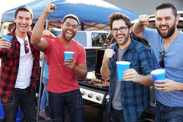 Group Of Male Sports Fans Tailgating In Stadium Car Park Royalty-free stock photo