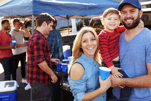 Portrait Of Family Group Tailgating In Stadium Car Park Royalty-free stock photo