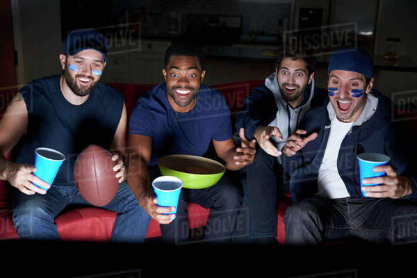 Group Of Male Sports Fans Watching Game On Television Royalty-free stock photo