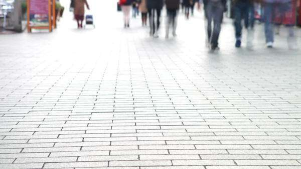 Timelapse sequence showing shopper's feet walking along busy street. Royalty-free stock video