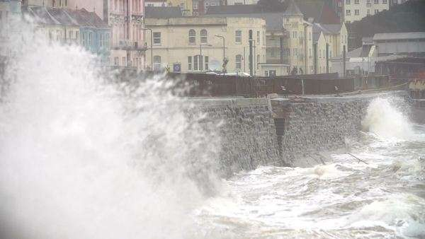 Slow motion sequence of waves breaking against sea wall at Dawlish in Devon. Royalty-free stock video