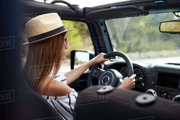 Young Woman Driving Open Top Car On Country Road Royalty-free stock photo