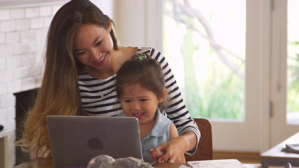 Mother and daughter watch movie on laptop at home together Royalty-free stock video