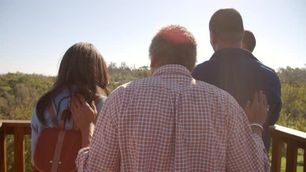 Multi generation family admiring view from deck, back view Royalty-free stock video