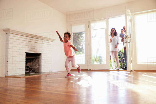 Excited family explore new home on moving day Royalty-free stock photo