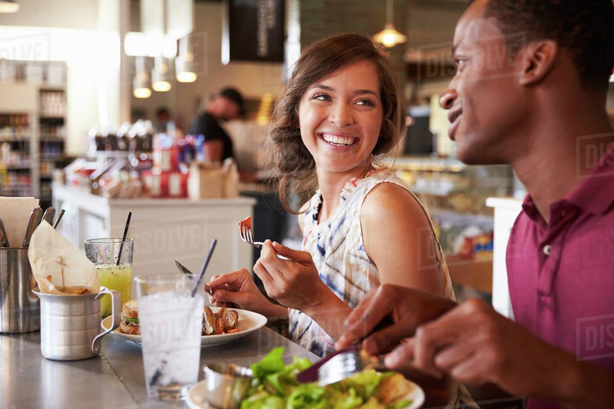 couple enjoying lunch date in delicatessen restaurant stock photo