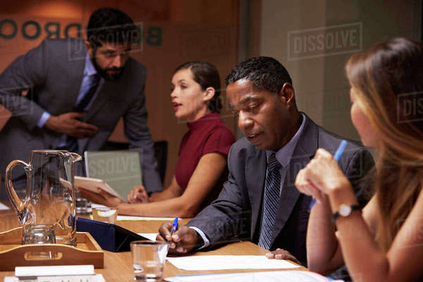 Business colleagues working together at a boardroom meeting Royalty-free stock photo