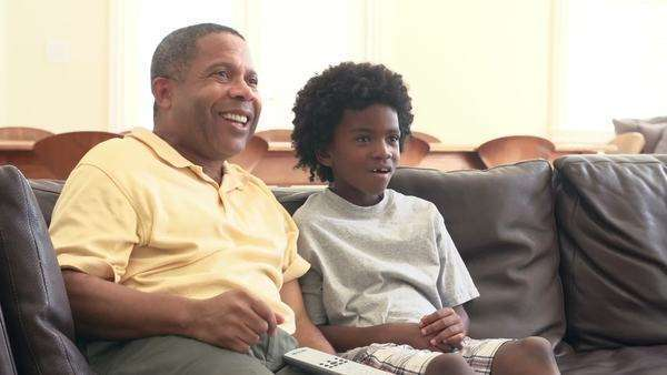 Grandfather and grandson watching television together Royalty-free stock video