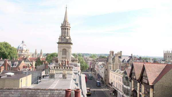 View across the Oxford city skyline showing buildings, churches and the dome of the Radcliffe Camera. Royalty-free stock video