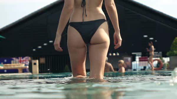 Free bikini girl walks around pool video