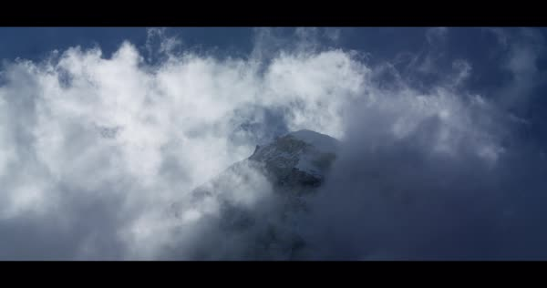 Static shot and timelapse view showing a mountaintop hidden by clouds Rights-managed stock video