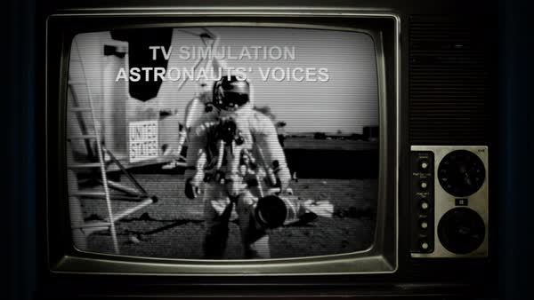 Static shot of a television set showing black and white footage of astronauts near a spacecraft Rights-managed stock video