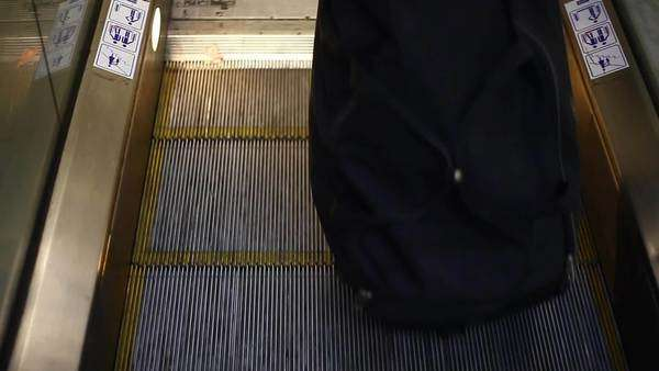 Medium shot of a woman on the escalator Royalty-free stock video