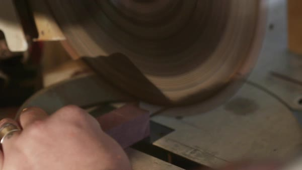 Hand-held shot of a man cutting a plank with a saw Royalty-free stock video