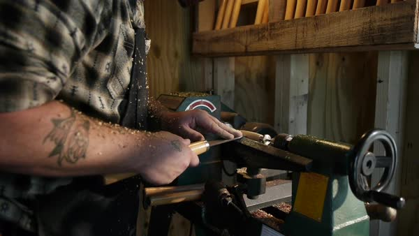 Static shot of a man shaping a piece of wood with a lathe Royalty-free stock video