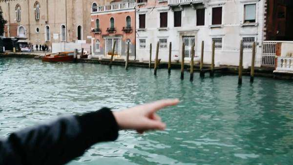 Girl on a boat navigating through Venice canals Royalty-free stock video