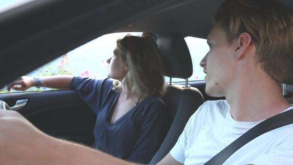 Medium shot of a young couple talking in a car Royalty-free stock video
