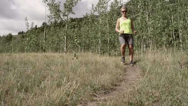 Slow motion of woman running in nature Royalty-free stock video