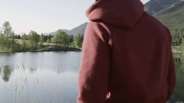 Slow motion of young man skipping stones at a lake Royalty-free stock video