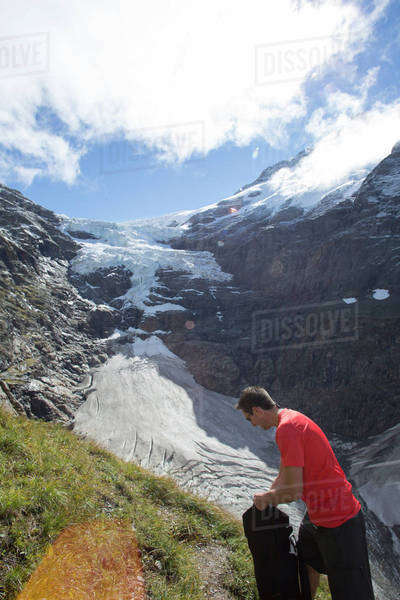 Man standing near a glacier Royalty-free stock photo