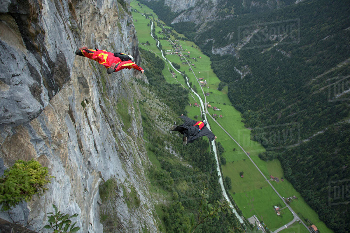Wingsuit flyers gliding in the air Royalty-free stock photo