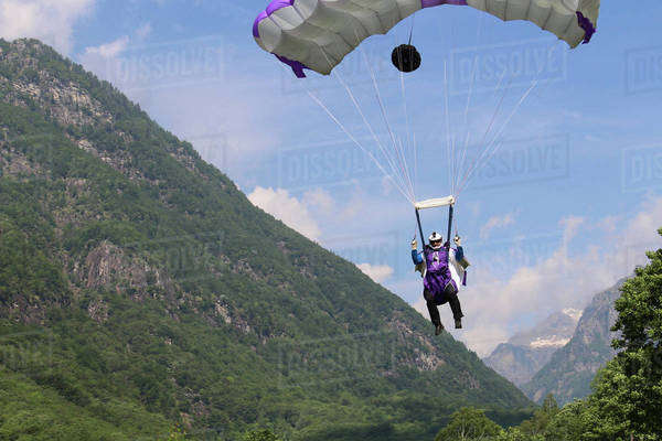 Wingsuit flyer gliding nearby a mountain in Ticino canton, Switzerland Royalty-free stock photo