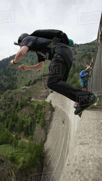 Man base jumping from the Contra dam in Ticino canton, Switzerland Royalty-free stock photo