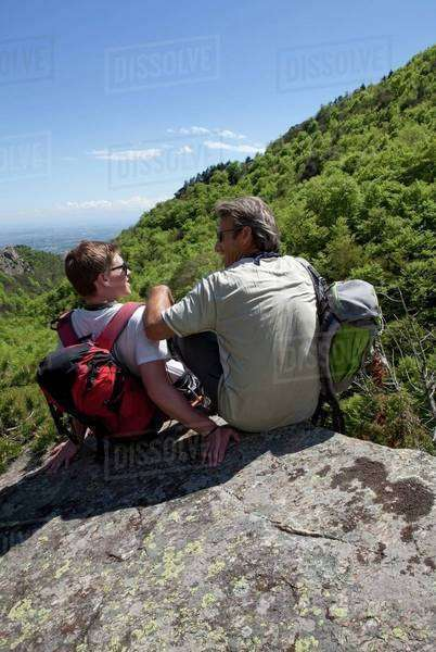 Father and son looking at each other in the mountains Royalty-free stock photo
