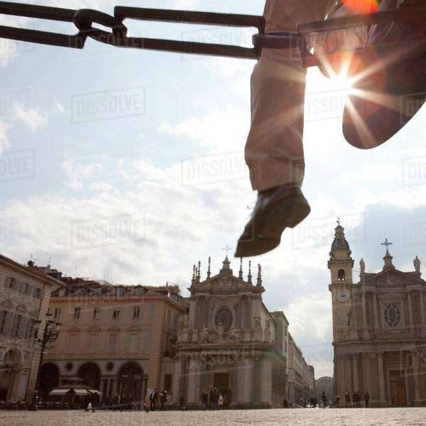 Detail of a leg jumping over a chain in a square Royalty-free stock photo