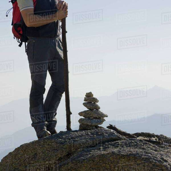 Man standing on a peak Royalty-free stock photo
