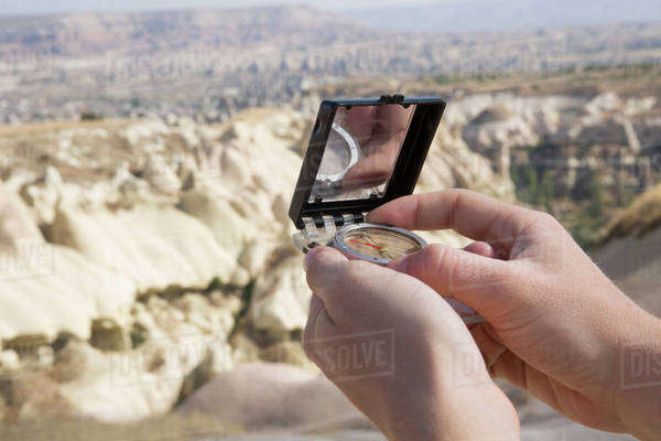 Orientating with compass in Cappadocia, Turkey Royalty-free stock photo