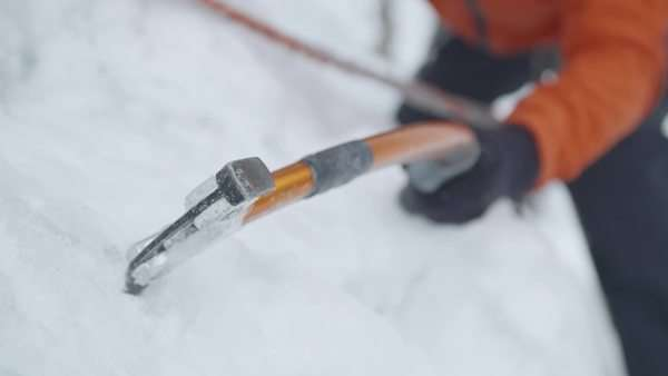 Slow motion of ice axe hitting the ice Royalty-free stock video