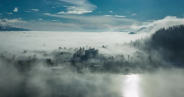 Timelapse of mist and clouds over Bled and lake Bled on a sunny day Royalty-free stock video