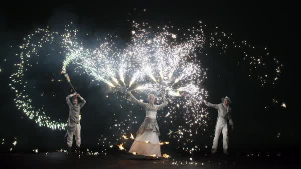 Group of three artists performing with sparkle contact staff during their stage performance Royalty-free stock video