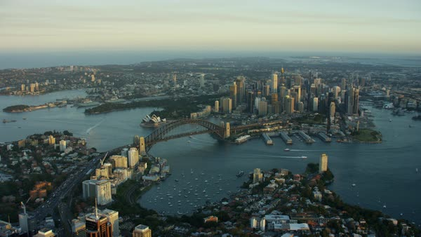 Aerial view of Sydney Harbor Bridge and Opera House sunset Royalty-free stock video