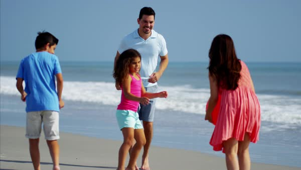 Family playing together on beach vacation with red ball Royalty-free stock video