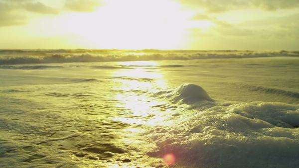 Sunset Reflecting Foam Covered Ocean Waves Royalty-free stock video