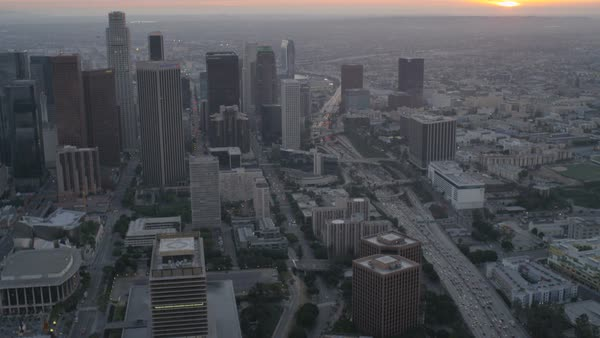 Aerial illuminated cityscape view at dusk of skyscrapers and elevated vehicle Highway in downtown Los Angeles California USA Royalty-free stock video