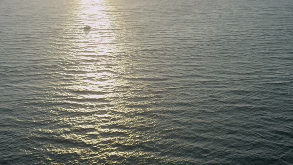 Aerial sunlight water view of setting sun with calm seas California Pacific Ocean USA Royalty-free stock video