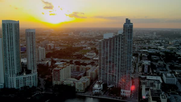 Aerial landscape sunset view of Downtown city Skyscrapers Miami Financial business District Biscayne Bay Florida USA Royalty-free stock video
