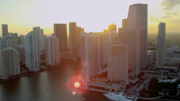 Miami USA - April 2017: Aerial sunset view across Biscayne Bay towards Brickell Key Miami City and Financial District Florida USA Royalty-free stock video