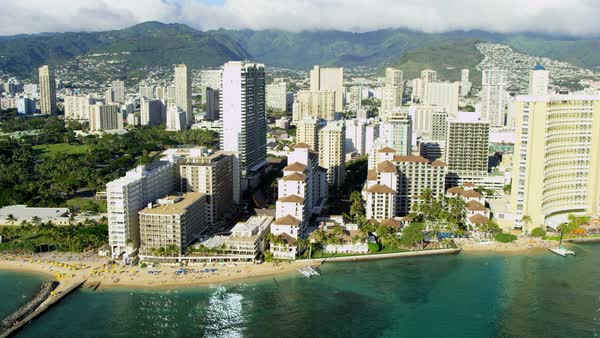 Aerial waterfront view of tropical Waikiki beach hotels and condominiums Oahu Hawaii USA Royalty-free stock video