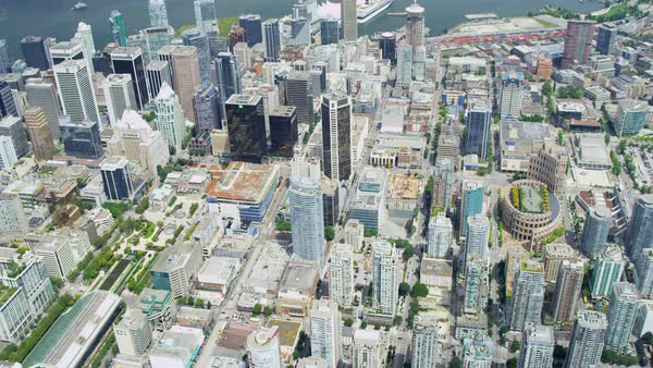 Aerial rooftop city view downtown Vancouver skyscrapers city roads commuter transport British Columbia Canada Royalty-free stock video