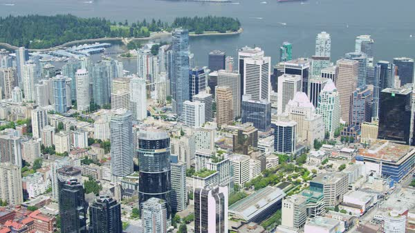 Aerial rooftop Cityscape view downtown Vancouver skyscrapers city roads commuter transport British Columbia Canada Royalty-free stock video